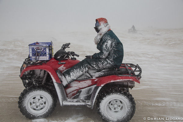 ATV driver and snow